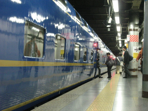 Many passengers took pictures. Some passengers looked travellers, other looked business man. (C) JP Rail