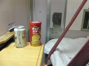 I had a can of beer and chips on the table. I watched night view through the window. it was the happiest moment. (C) JP Rail